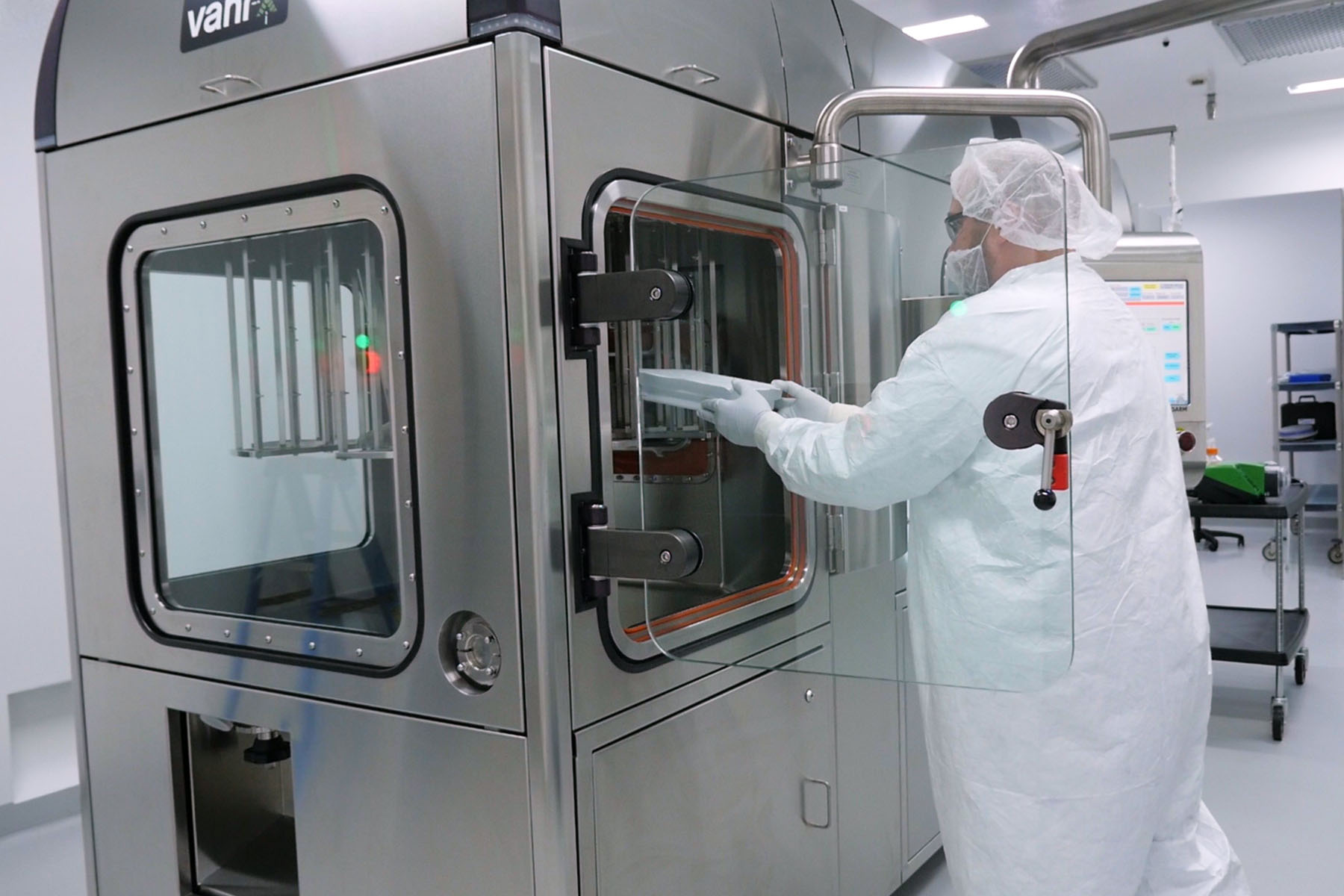 Operator prepares the SA25 Aseptic Filling Workcell in a cleanroom at FUJIFILM Diosynth Biotechnologies.